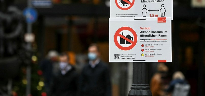 GERMANY SETS TOUGH NEW VIRUS CURBS AS GLOBAL CASES HIT RECORD
