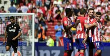 Costa watches as Atletico beats Sevilla to go 2nd in Spain