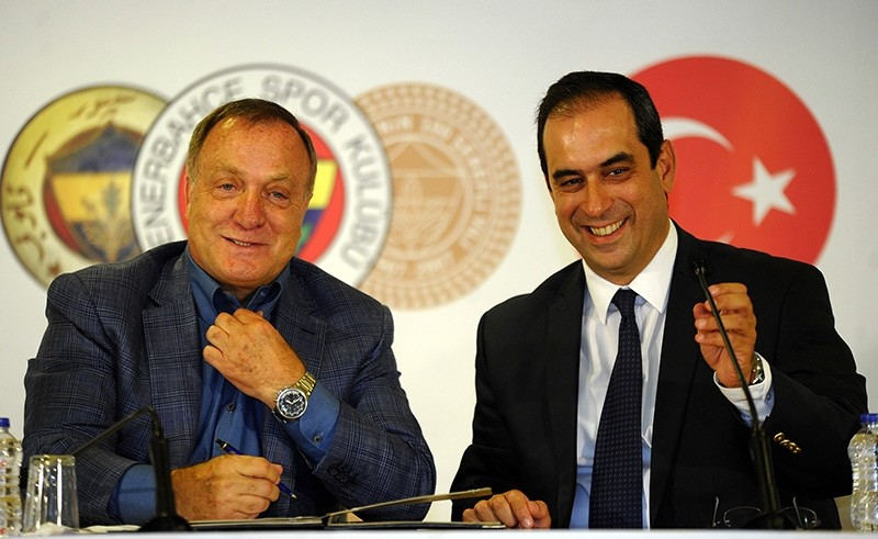 Dutch manager Dick Advocaat (L) poses with Fenerbahu00e7e's vice president u015eekip Mosturou011flu (R) during the signing ceremony in Fenerbahu00e7e u015eu00fckru00fc Sarau00e7ou011flu Stadium, Istanbul, Aug 17, 2016. (IHA Photo)