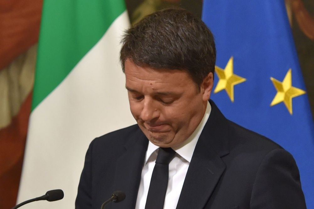 Italian PM Renzi announces his resignation during a press conference at the Palazzo Chigi following the results of the vote for a referendum on constitutional reform Dec. 5.