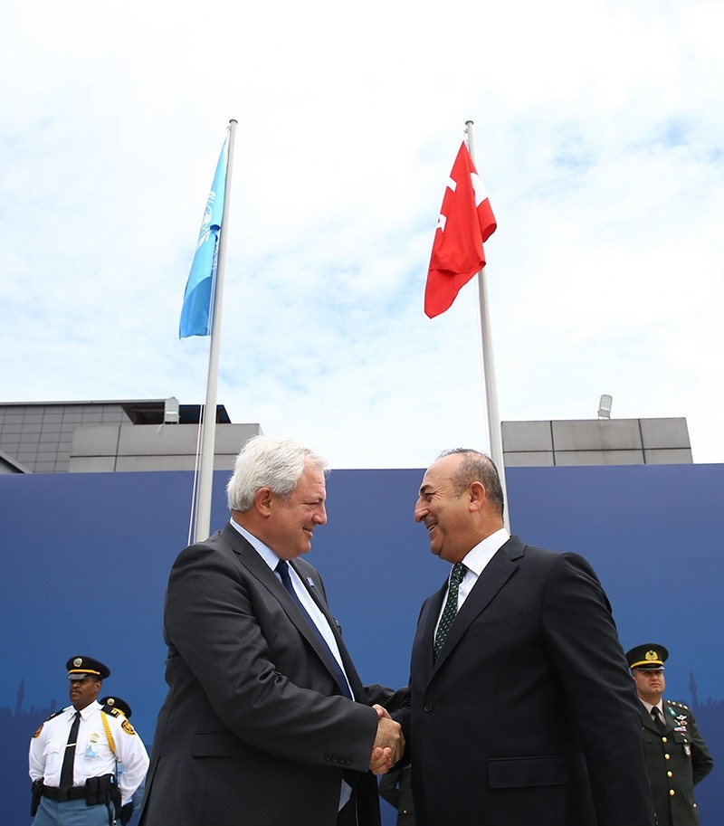 FM u00c7avuu015fou011flu and the United Nations' Under-Secretary-General for Humanitarian Affairs and Emergency Relief Coordinator Stephen O'Brien at the flag-hoisting ceremony on May 21, 2015. ( AA Photo)
