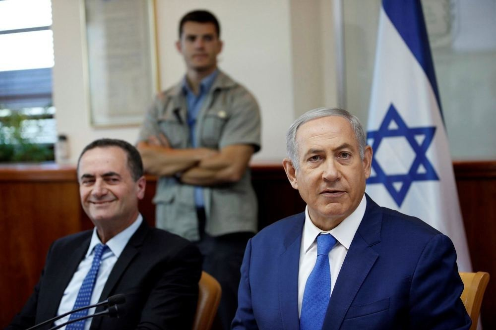 Israel's Prime Minister Benjamin Netanyahu, right, and Transportation Minister Yisrael Katz.