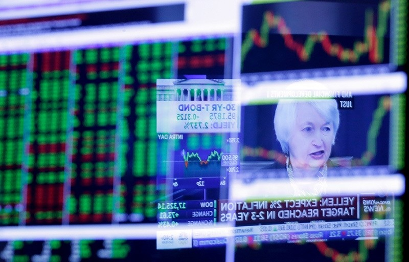 In this Wednesday, March 16, 2016, file photo, the Washington news conference of Federal Reserve Chair Janet Yellen is reflected in a specialist's screen on the floor of the New York Stock Exchange (AP Photo)