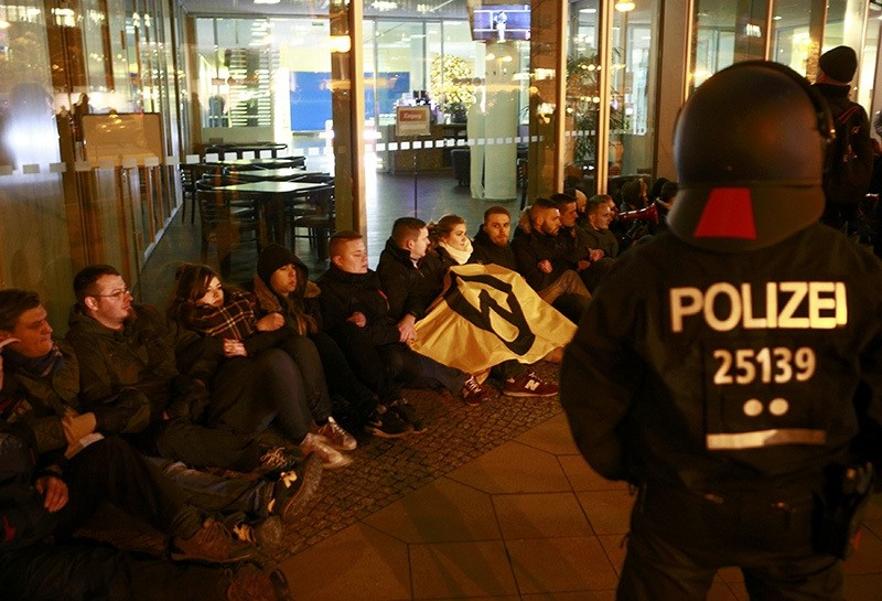 German police monitors supporters of the far right Identitarian movement (Identitaere Bewegung) who started a protest in front of the CDU headquarters in Berlin (Reuters Photo)