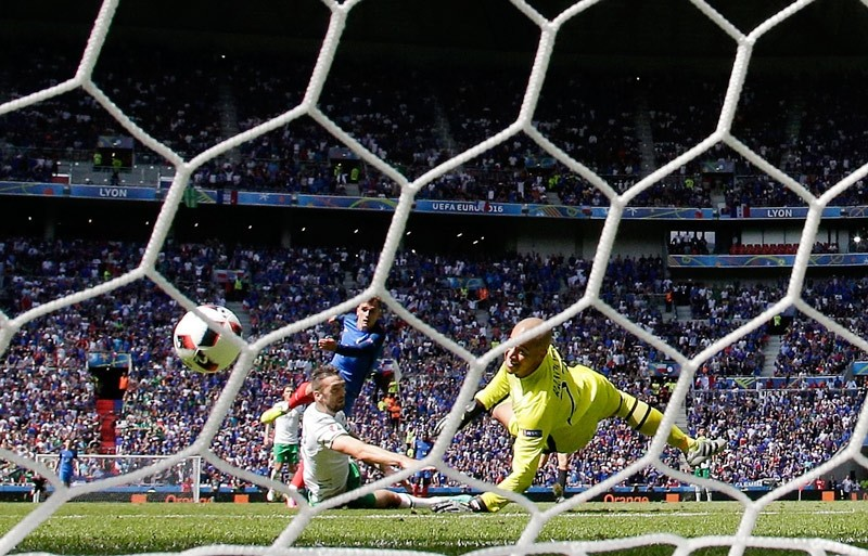 France's Antoine Griezmann scores his side's second goal during the Euro 2016 round of 16 soccer match between France and Ireland on Sunday, June 26, 2016.  AP Photo