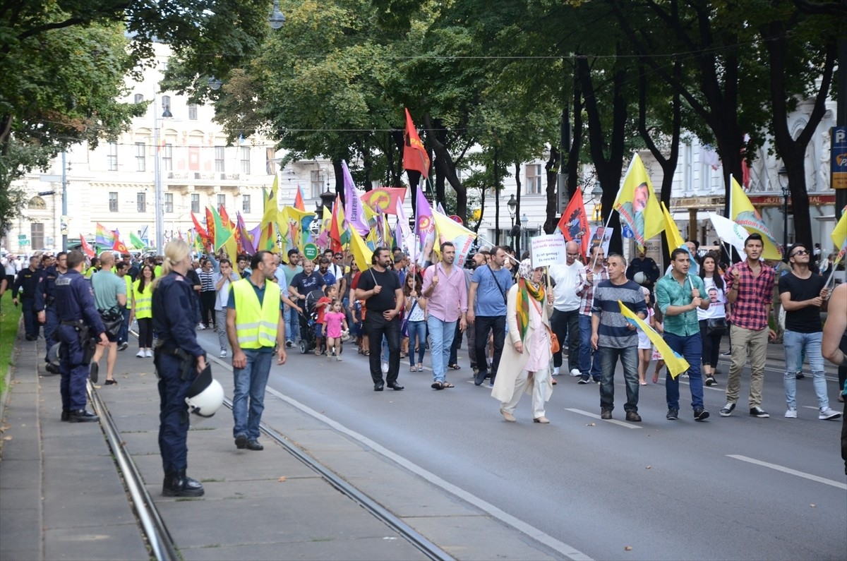 A group of PKK supporters march in central Vienna with the group's banners and the jailed leader Abdullah u00d6calan's pictures