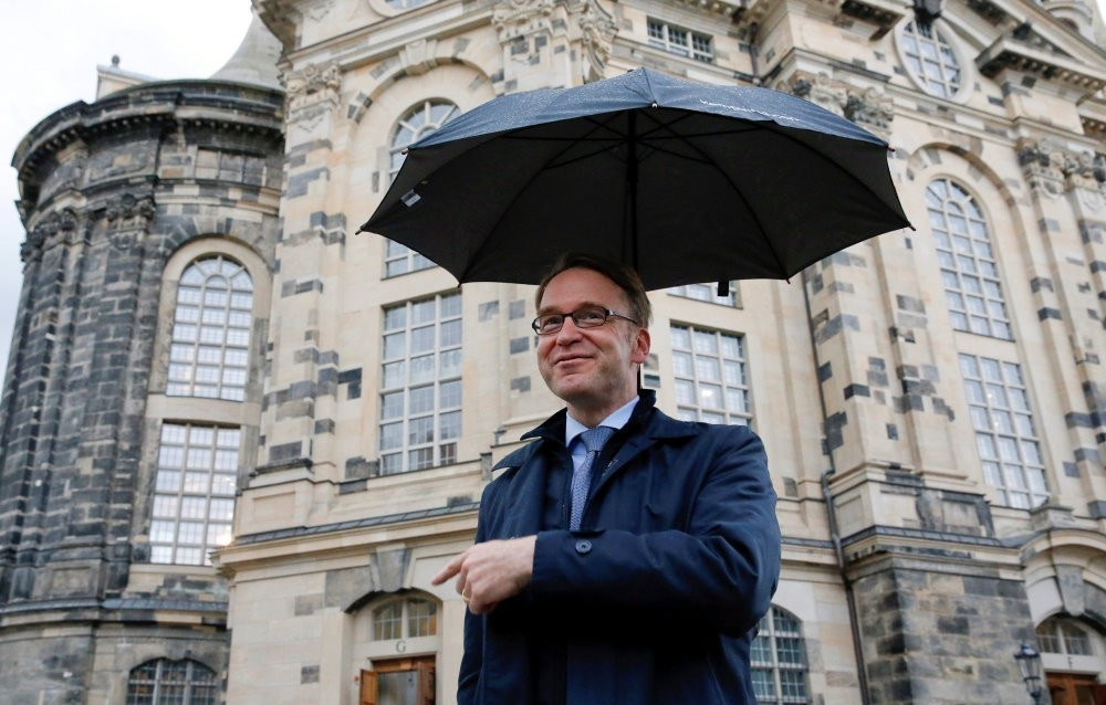 Germanyu2019s Deutsche Bundesbank President Jens Weidmann gestures in front of the Frauenkirche cathedral in Dresden. On Friday, the bank cut its growth forecast for German economy from 1.7 to 1.4 percent this year.