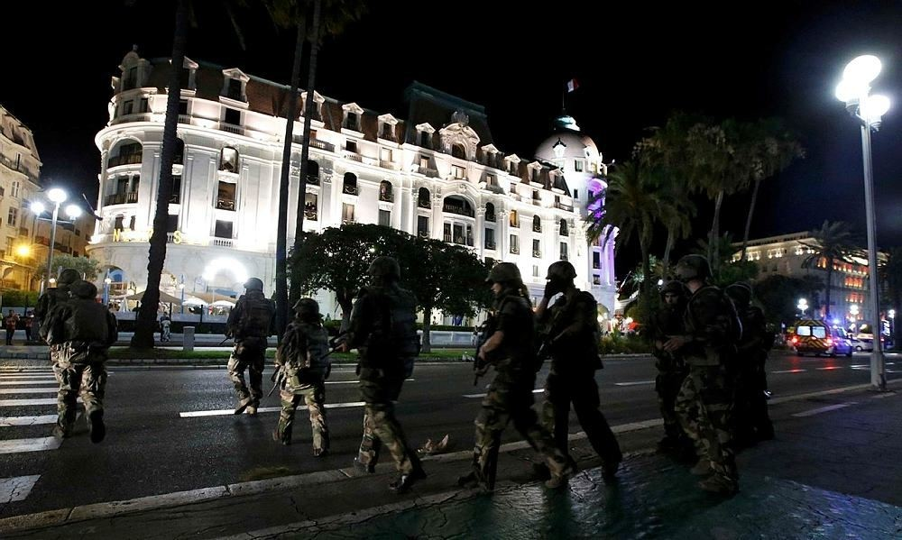 French soldiers advance on the street after at least 30 people were killed in Nice, France, when a truck ran into a crowd celebrating the Bastille Day national holiday July 14, 2016. (Reuters Photo)
