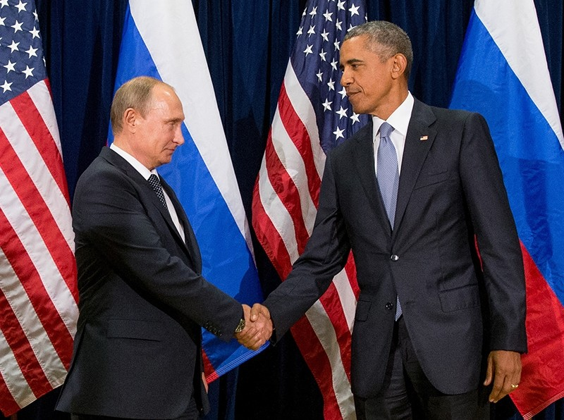 In this Sept. 28, 2015 file photo, President Barack Obama shakes hands with Russian President President Vladimir Putin before a bilateral meeting at United Nations headquarters. (AP Photo)