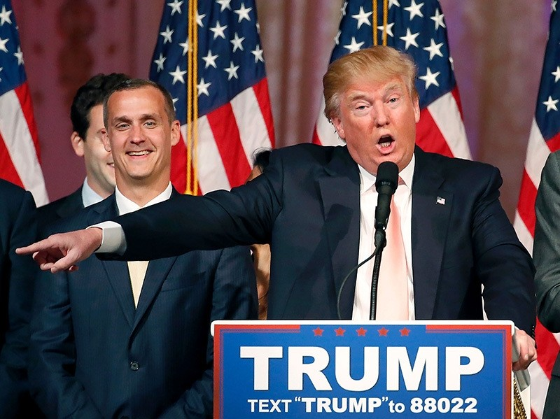 This file photo taken on March 15, 2016 shows Republican presidential candidate Donald Trump with his campaign manager Corey Lewandowski(L)  (AFP Photo)