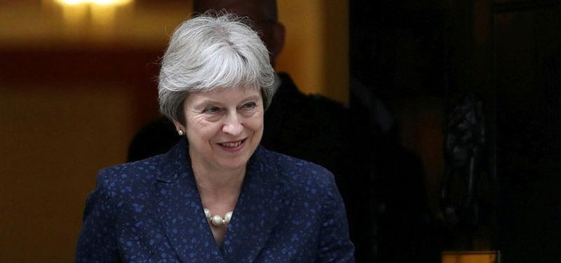 MAY DEFENDS BREXIT PLAN AFTER CABINET DEPARTURES