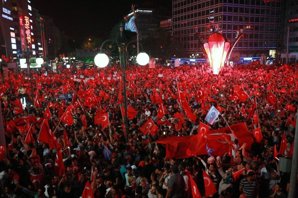 People waving flags as they celebrates in Ankara's Ku0131zu0131lay Square in support of the government following the failed coup attempt, July 16.