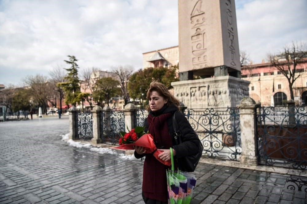 Sibel u015eatu0131rou011flu, Turkish tour guide who survived the attack, stood alone at the blast site yesterday before laying flowers in memory of victims.