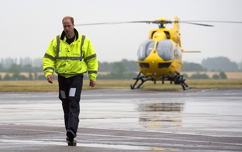 Britain's Prince William walks away from his helicopter as he begins his new job as a co-pilot with the East Anglian Air Ambulance (EAAA) at Cambridge Airport, Britain July 13, 2015. (AFP Photo)