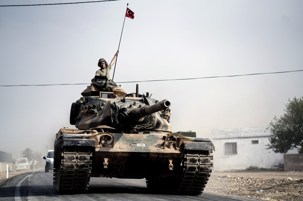 Turkish army tanks and armored personnel carriers moving toward Karkamu0131u015f in southeastern Gaziantep province on Turkey's border with Syria, Aug. 25.