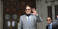 Johnny Depp was punched by ex-wife Heard, UK court told