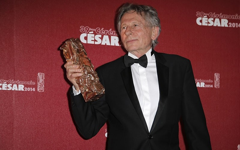 In this Friday Feb. 28, 2014 file picture, Polish-French film director Roman Polanski holds his best director award during the 39th French Cesar Awards Ceremony in Paris, France. (AP Photo)