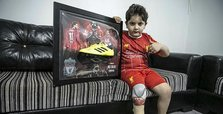 Mo Salah-signed gifts bring joy to Syrian child amputee