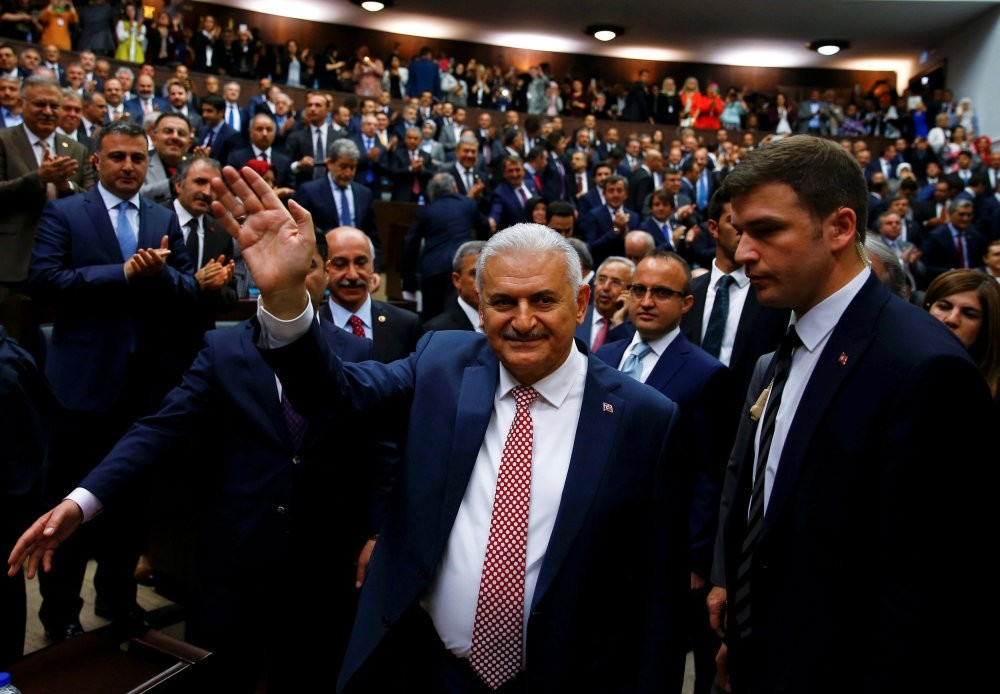 Turkey's new PM Binali Yu0131ldu0131ru0131m greeting AK Party deputies as he arrives for a meeting at Parliament in Ankara, May 24, 2016.
