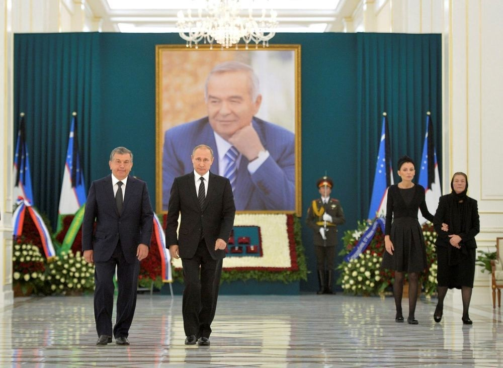 Russian President Vladimir Putin walks with Uzbek interim President Shavkat Mirziyoyev as he takes part in a wreath-laying ceremony in memory of Islam Karimov in Samarkand, Uzbekistan, Sept. 6.