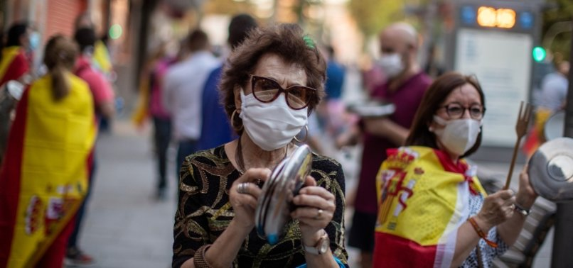 SPAIN REVISES CORONAVIRUS DEATH TOLL DOWN BY NEARLY 2,000