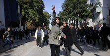 Tunisians protest activists' arrest, decline in economy