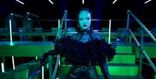Rihanna wants to cheer up a troubled world with fashion show