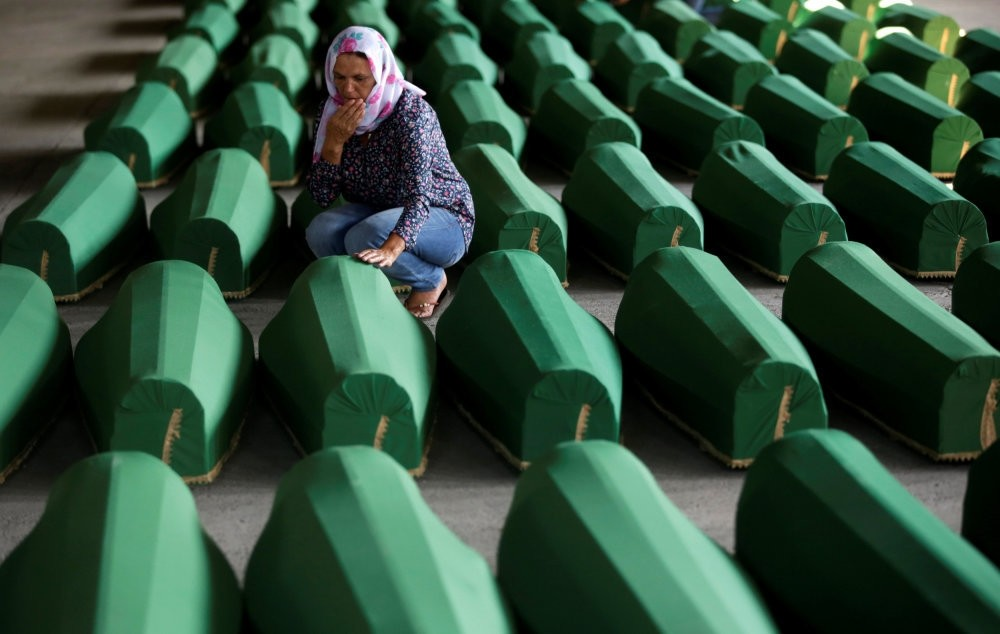 Muslim women crying amid coffins of their relatives, who are newly identified victims of the 1995 Srebrenica massacre, which are lined up for a joint burial in Potocari near Srebrenica, Bosnia-Herzegovina, July 9, 2016.