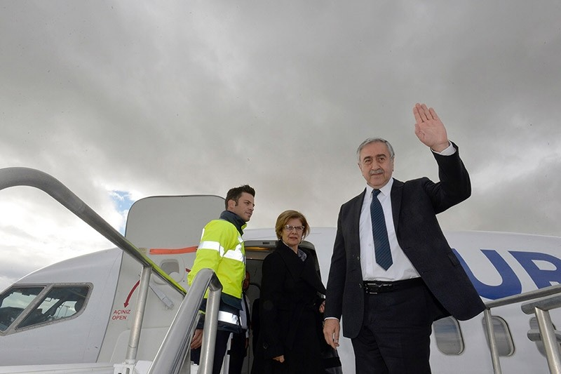 President of the Turkish Republic of Northern Cyprus (KKTC) Mustafa Aku0131ncu0131 (R) waves as he boards a plane at Ercan Airport in Turkish Republic of Northern Cyprus on Jan. 8, 2017. (AFP Photo)