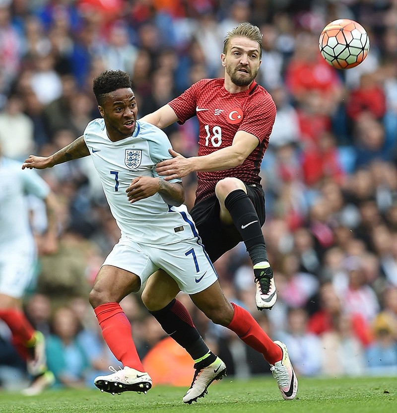 England's midfielder Raheem Sterling (L) vies with Turkey's midfielder Caner Erkin during the friendly football match between England and Turkey at the Etihad Stadium in Manchester, north west England, on May 22, 2016. (AFP Photo)