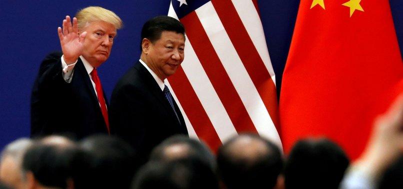 TRUMP WARNS CHINA AGAINST DRAGGING ITS FEET IN TRADE TALKS