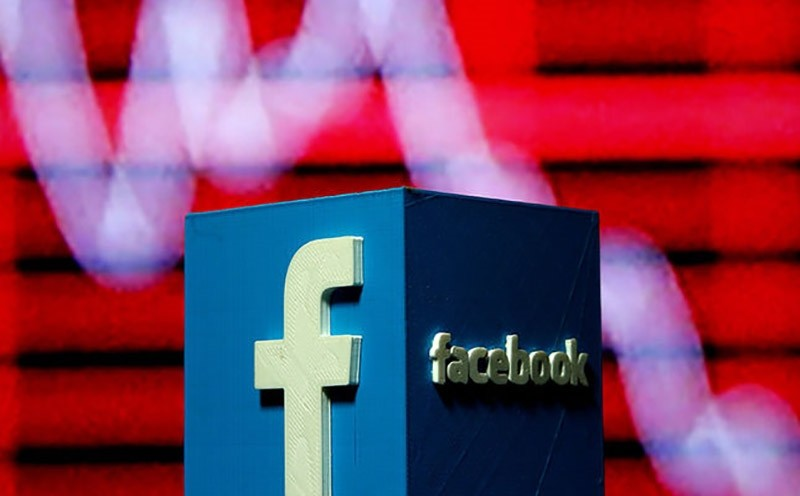 A 3D-printed Facebook logo is seen in front of a displayed stock graph in this illustration taken Nov. 3, 2016. (Reuters Photo)