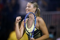 Maria Sharapova set foot on a tennis court for the first time since her positive drug test at the Australian Open on Monday, smiling throughout an appearance in the World Team Tennis Smash Hits...