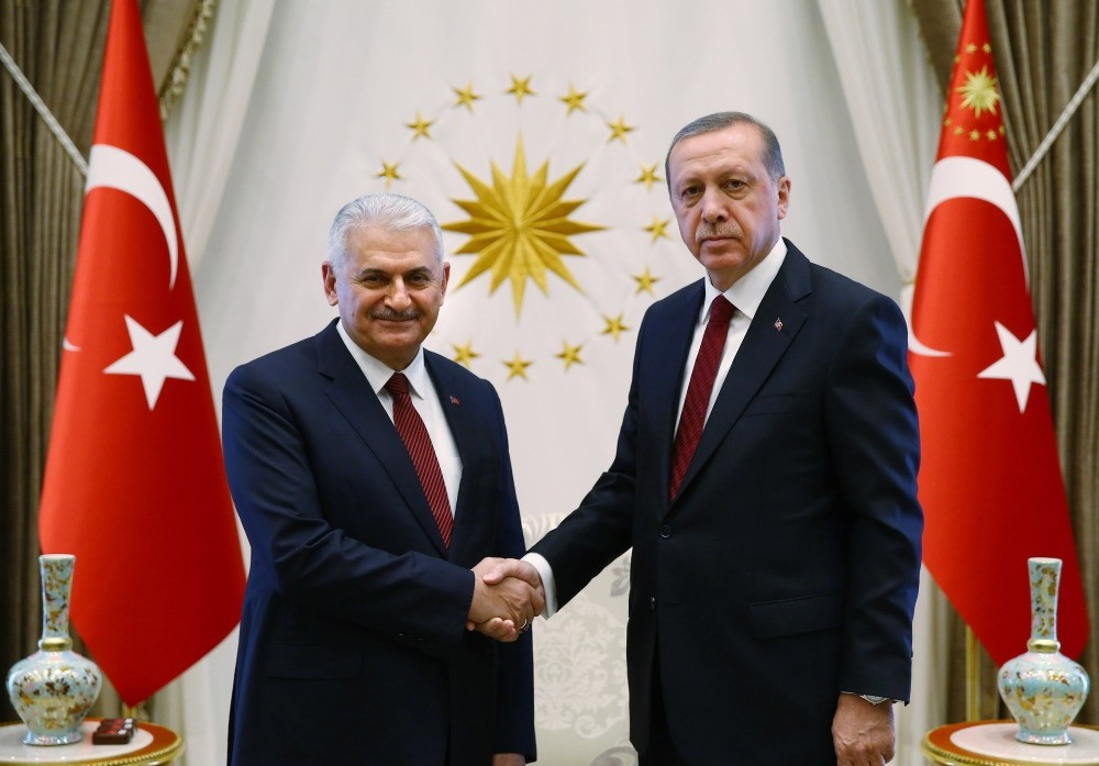Prime Minister Yu0131ldu0131ru0131m (L) and President Erdou011fan shake hands prior to the meeting of 65th Cabinet of Turkey in Ankara on May 25.