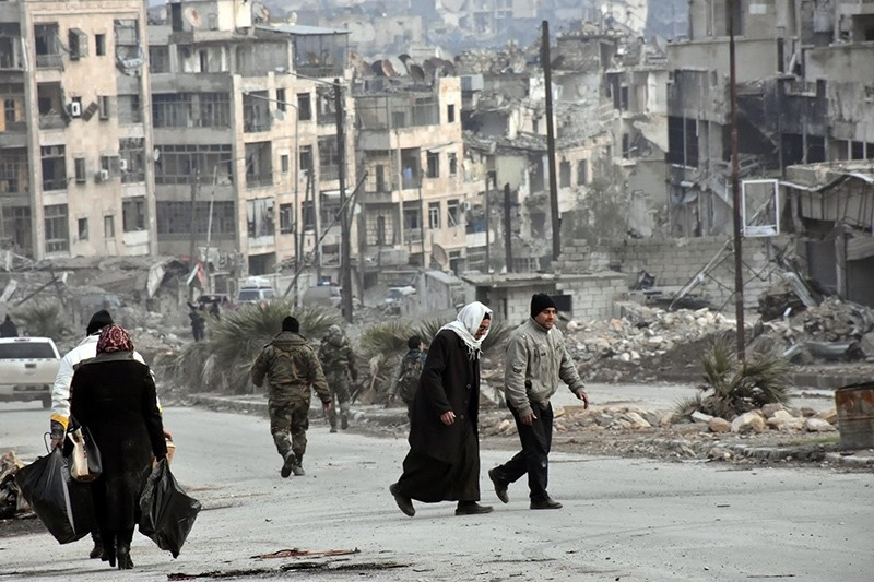 A handout photo shows people walking in Zabadia and Salah Eddin district in Aleppo, Syria, 23 December 2016 (EPA Photo)