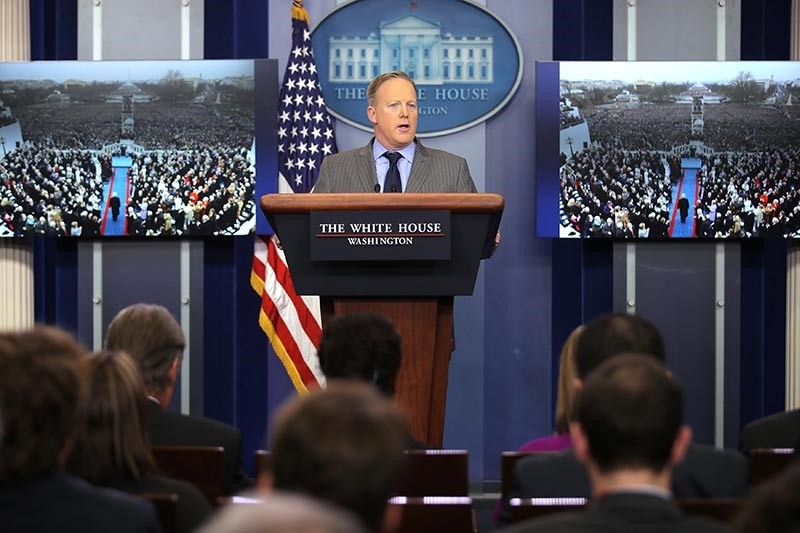 Press Secretary Sean Spicer delivers a statement while television screens show pictures of U.S. President Donald Trump's inauguration at the press briefing room of the White House (Reuters Photo)