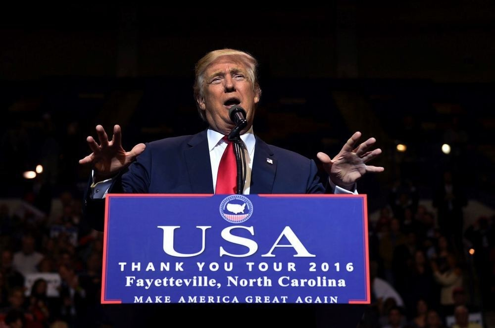 US President-elect Donald Trump speaks at the Crown Coliseum in Fayetteville, North Carolina on Dec. 6, during his USA u2018Thank Youu2019 tour.