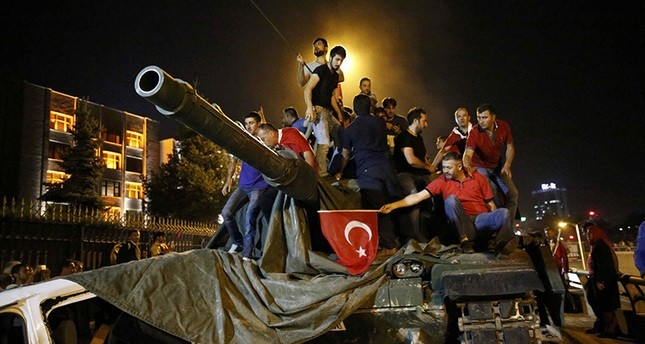 People stand on a Turkish army tank in Ankara, Turkey July 16, 2016. (Reuters Photo)