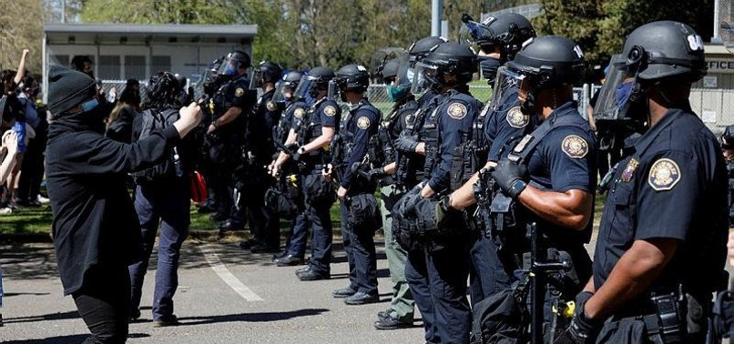 RIOT DECLARED AFTER POLICE KILL MAN IN OREGON PROTESTS