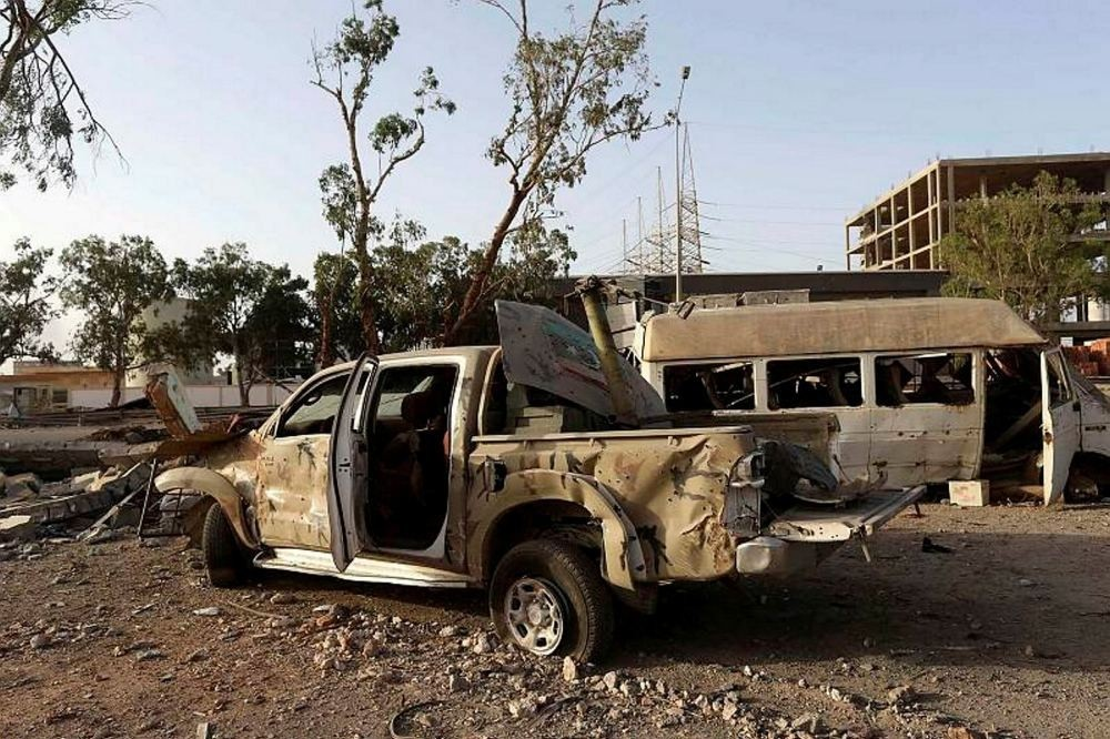 Destroyed vehicles were seen after fighting between rivals in the eastern city of Benghazi.