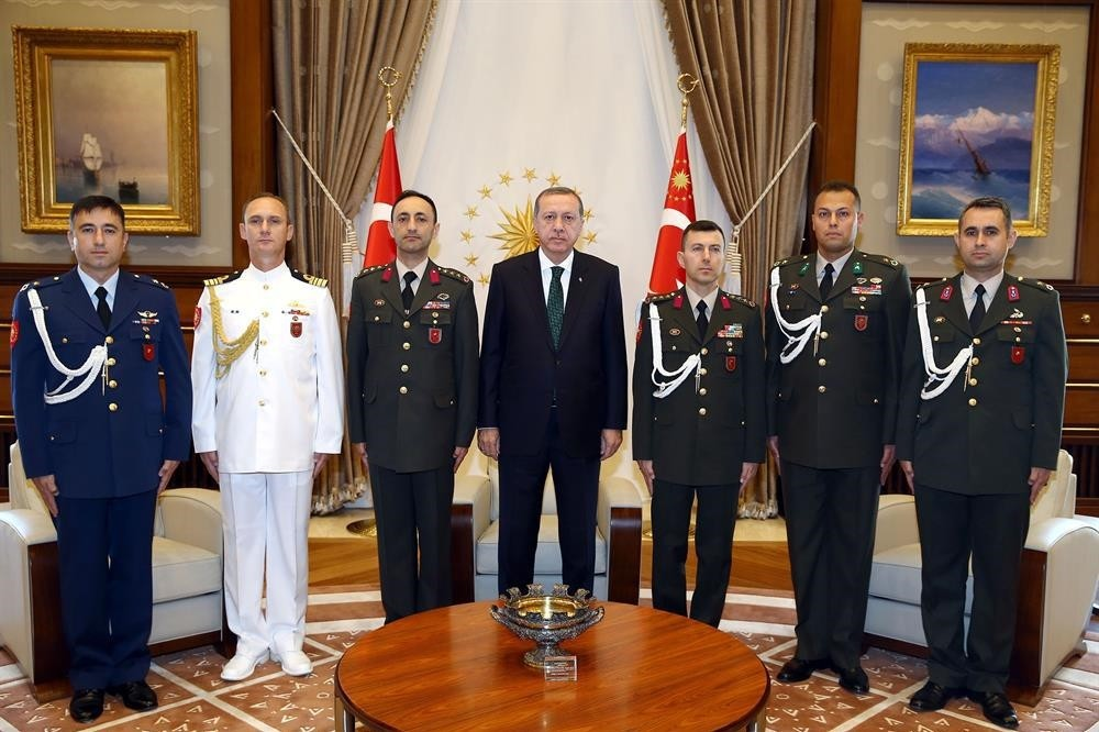 In this file photo, President Recep Tayyip Erdou011fan is pictured with his aides, including Erkan Ku0131vrak (on his left side)