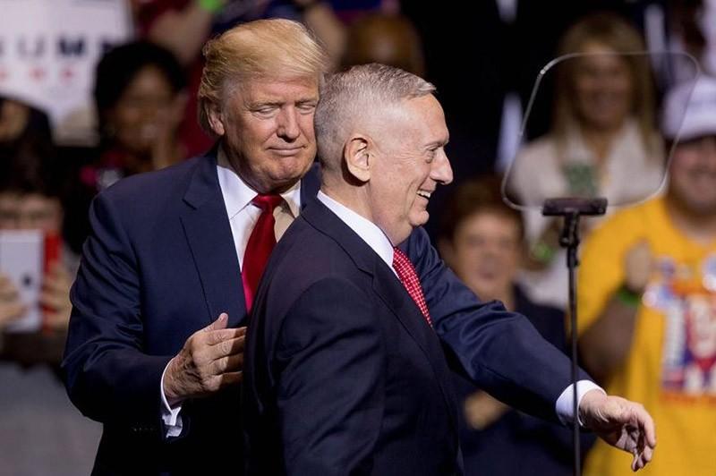 Defense secretary nominee James N. Mattis, right. (AP Photo)