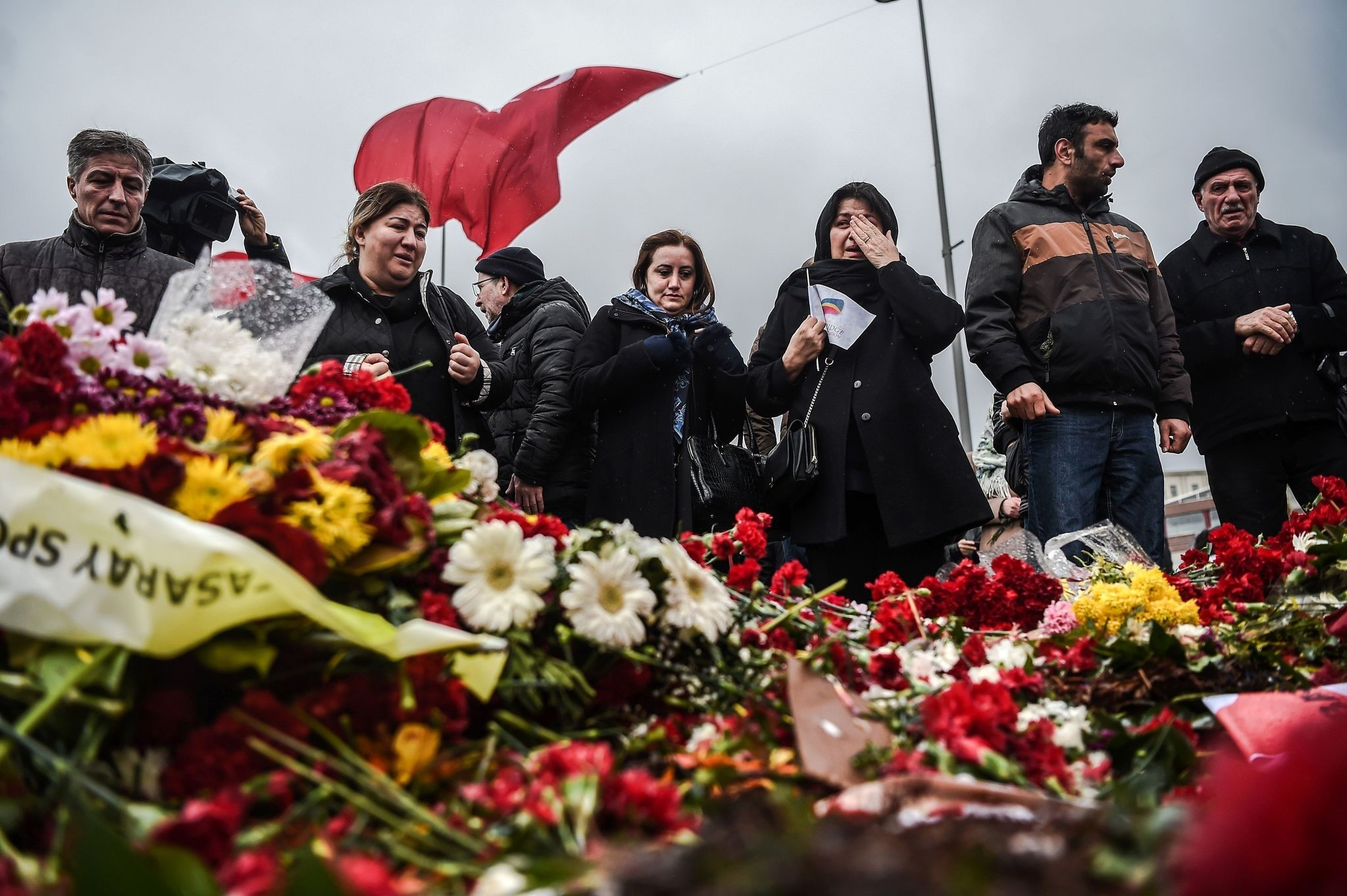 People lay flowers for the victims of the Dec. 10 blasts outside Beu015fiktau015f Vodafone Arena football stadium Tuesday.