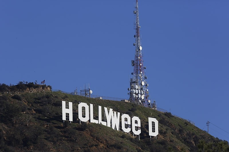 The Hollywood sign is seen vandalized Sunday, Jan. 1, 2017. Los Angeles residents awoke New Year's Day to find a prankster had altered the famed Hollywood sign to read ,HOLLYWeeD. (AP Photo)