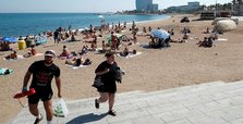 Barcelona police clear beach amid report of explosive device