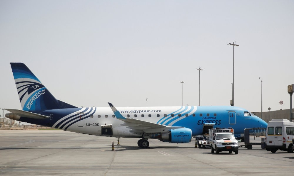 Workers service an EgyptAir flight at the Cairo airport, May 21.