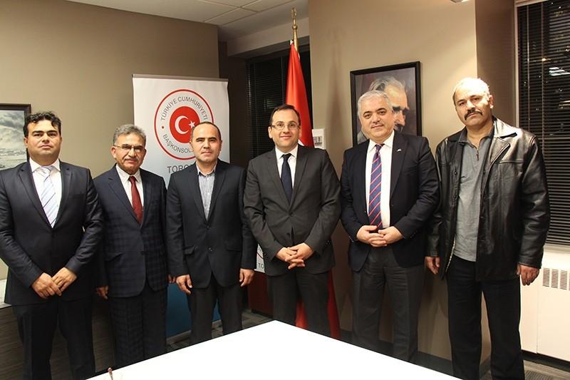 Members of KATu0130B visited Turkey's Consul General Erdem u015een (Third in the right) in Toronto (AA Photo)
