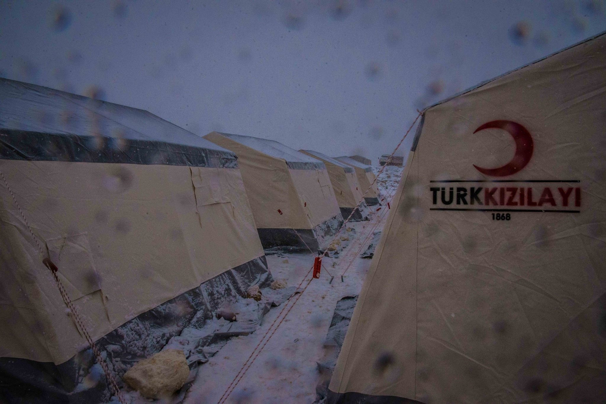 Cooperating with other Turkish NGOs, the Turkish Red Crescent started to establish new camps and provide extra aid to the existing ones while some families were reunited and started to live in the same shelter in Idlib.