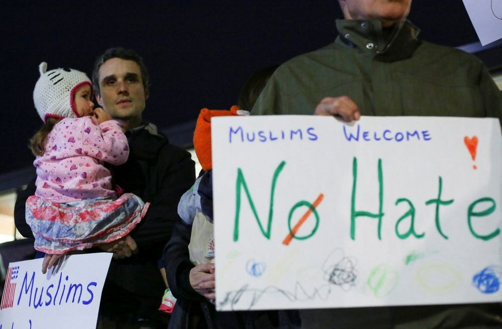 Demonstrators hold signs in support of Muslim residents in downtown Hamtramck, Michigan on Nov. 14.