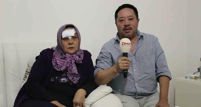 Şeherben Durmaz speaking to the media with her husband Mahmut Durmaz (DHA Photo)